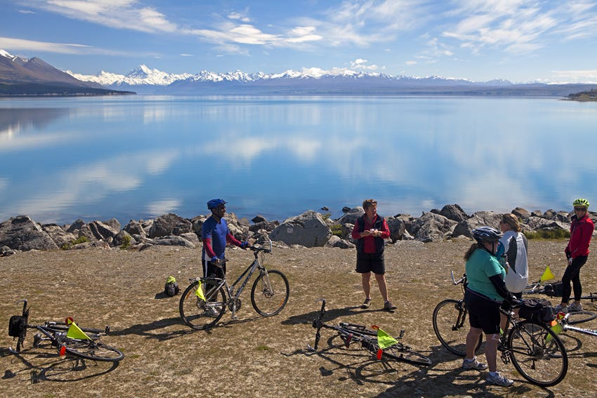 Cycling group at Lake Pukaki with Mt Cook beyond