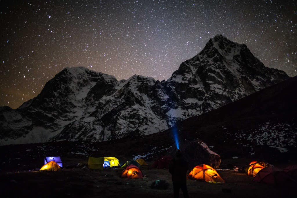 Base camp on Lobuche East with Cholatse towering above - our Black Diamond head torch from Paddy Pallin came in super handy for our early rises and night photography. Tina Lacey