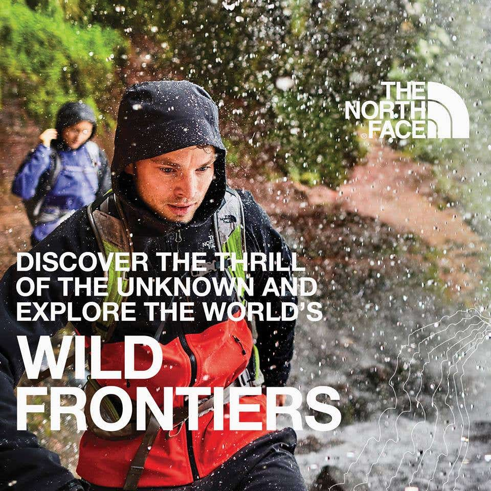 Adventurer pushing wild frontiers in water repellant jacket.