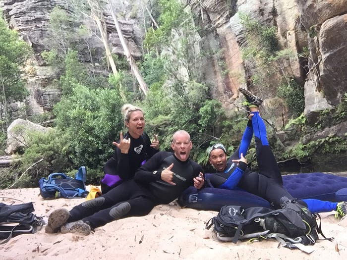 Paddy Pallin Wild Rivers Photo Contest - People's Choice Award, 3 adventurers doing a silly pose as they take a break from floating and scrambling through the Wollongambie Dam canyon.