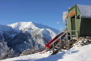 View of Mount Feathertop with Memorial Hut and frozen boots