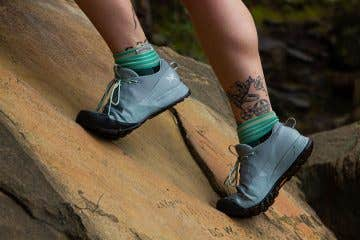 Konseals providing the ultimate grip as mountain adventurer climbs rock.