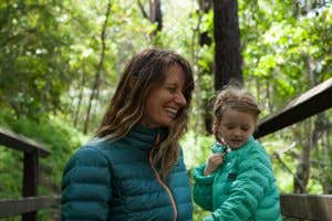 Adventure mum Nell and her daughter wearing the Patagonia Down Sweaters while out in the wilderness together.