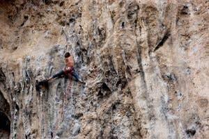 Kerry Xu climbing a large rock crag in Turkey