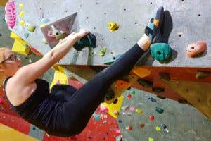 Climbing in an indoor climbing gym in the Arc'teryx Oriel leggings