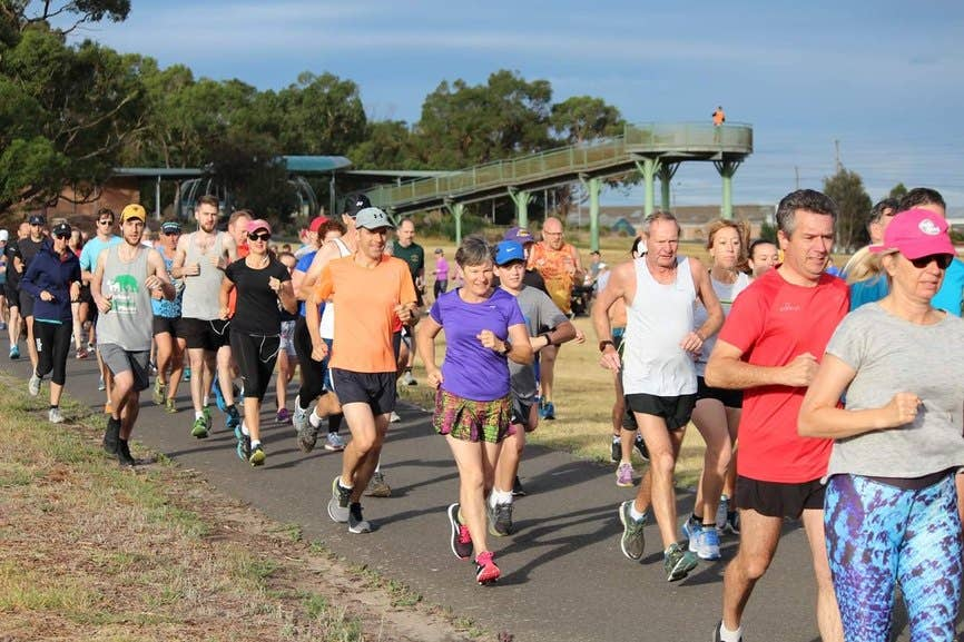 Trail runners setting off on a large group run