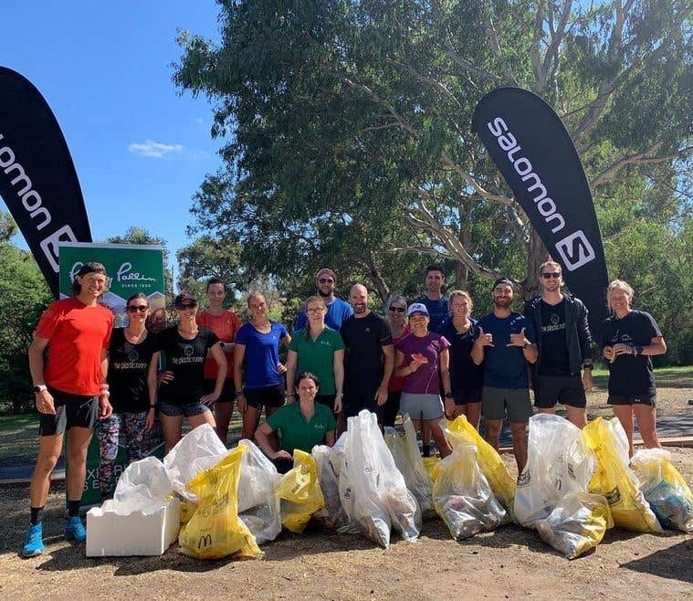The plastic runner and a group of trail runners after a run picking up litter