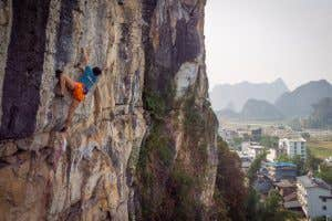 Female Paddy staffer hitting the crag