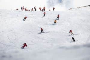 Skiers carving down a slope in Cadrona in The North Face Futurelight gear