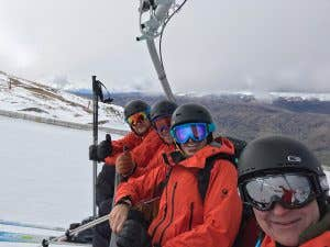Skiiers on a chairlift wearing The North Face Futurelight gear
