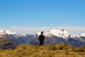 Hiker Looking out over the Alps in NZ
