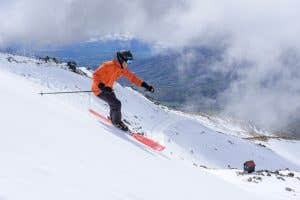 Skiier in The North Face's Futurelight carving down a mountain in Cadrona in New Zealand