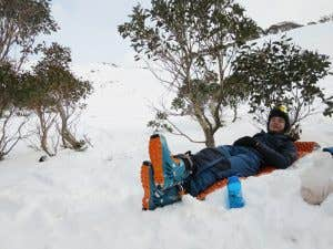Laying back for a break in the snow on a Nemo Switchback mat on a backcountry trip