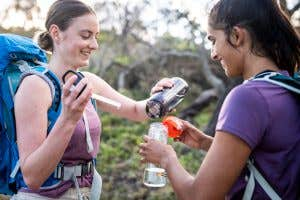 Hikers sharing water out on the trail