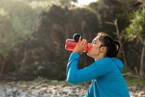 Hiker enjoying a refreshing drink on the trail