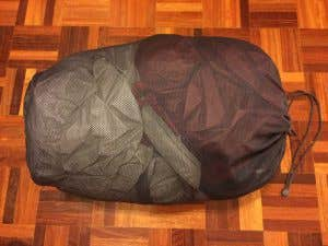 A loosely packed up hiking tent for storage